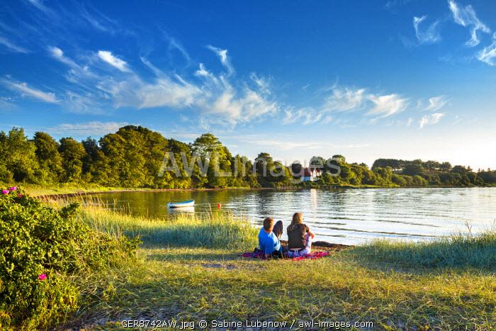Couple at beach, Holnis peninsula, Flensburg fjord, Baltic coast, Schleswig-Holstein, Germany