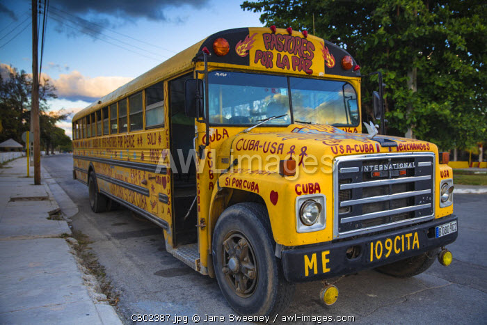 Cuba, Varadero, American yellow school bus, given to aid USA - Cuban relations