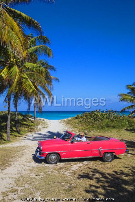 Cuba, Varadero, Pink Plymouth car on Varadero beach