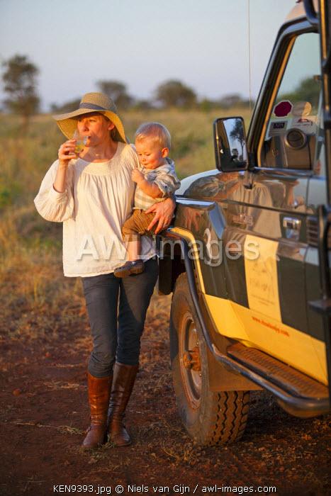 Kenya, Meru National Park. Mother and son with a safari vehicle in Meru National Park. MR.