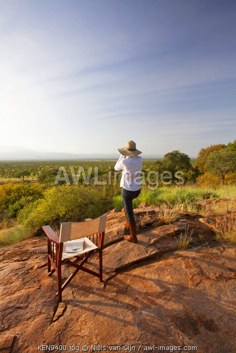 awl-images.com - Kenya / Kenya, Meru National Park. A young lady looks out over Meru National Park.