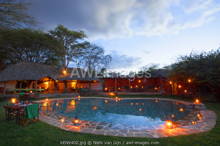 Kenya, Lewa Conservancy, Lewa Safari Camp. Dinner set around the pool at Lewa Safari Camp.