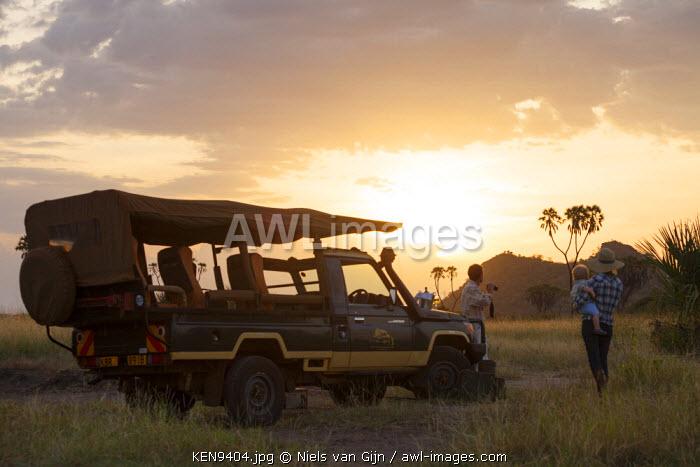 Kenya, Meru National Park. A family enjoy the evening light.