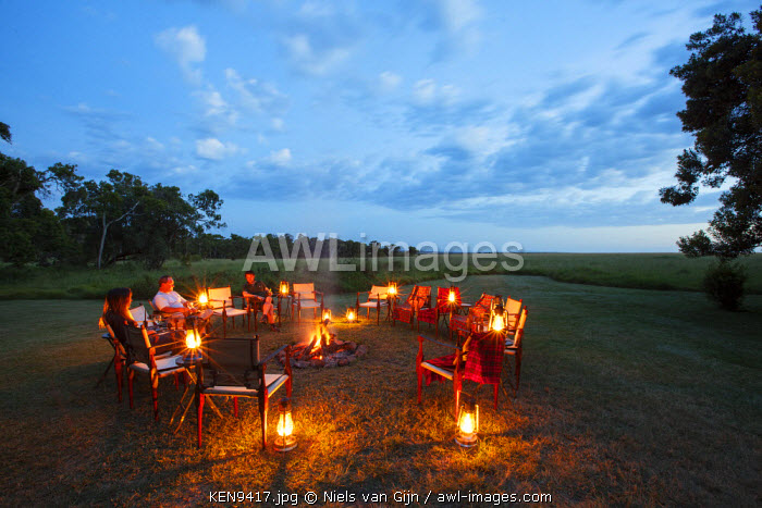 Kenya, Mara North Conservancy, Elephant Pepper Camp. Guests enjoy a sundowner.