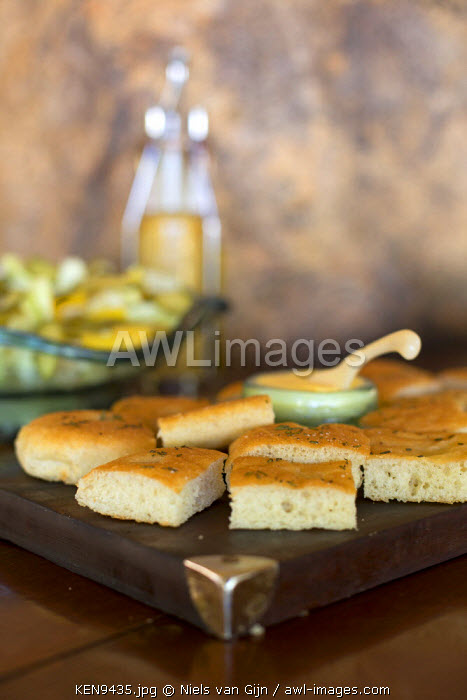 Kenya, Meru. Focaccia bread and butter on a wooden board.