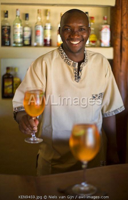 Kenya, Meru. A barman serves a fresh drink.