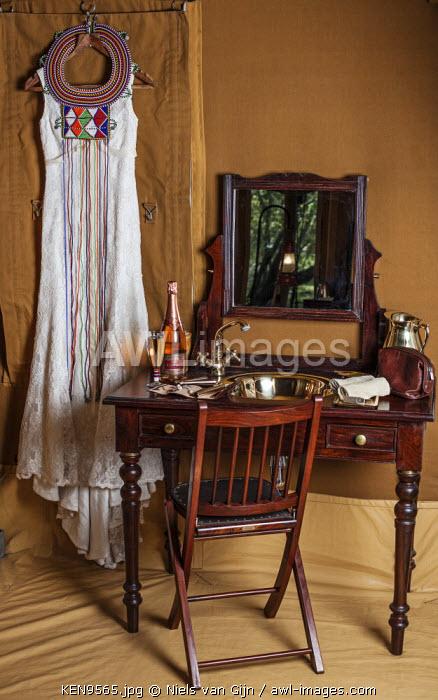 Kenya, Mara North Conservancy. A vintage-style wedding dress hangs ready for a safari wedding.