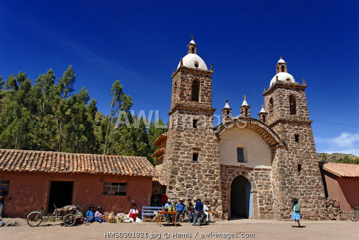 Peru, Cuzco Province, Raqchi, craft and shopping centre, in the month of may on the church's square takes place the most well known traditional festival of the country