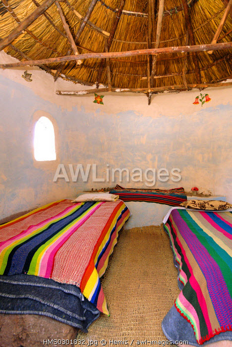 Peru, Puno Province, lake Titicaca, island of Ticonata, Putucos, small house made of rustic materials and decorated with fabrics and handmade embroidery