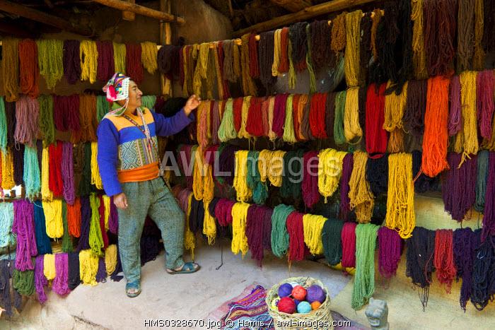 Peru, Cuzco Province, Incas sacred valley, Chinchero, Quechua peasant showing his stall of llama and alpaca wool