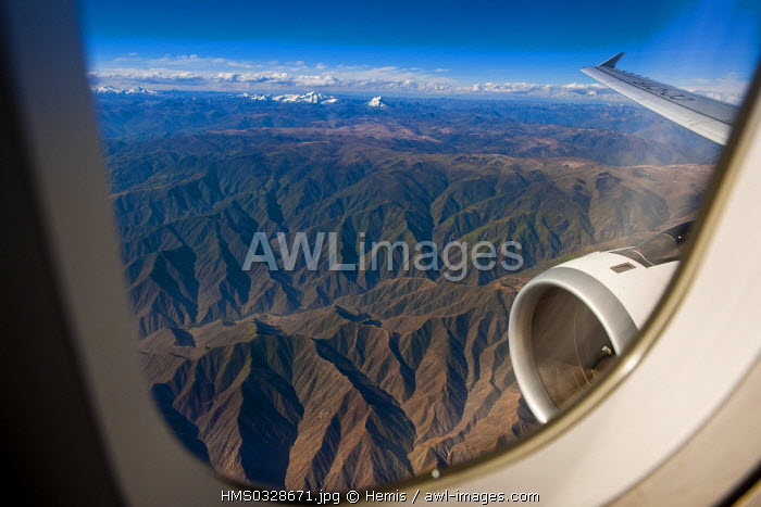 Peru, the Andes Mountains between Cuzco and Lima seen through a plane window