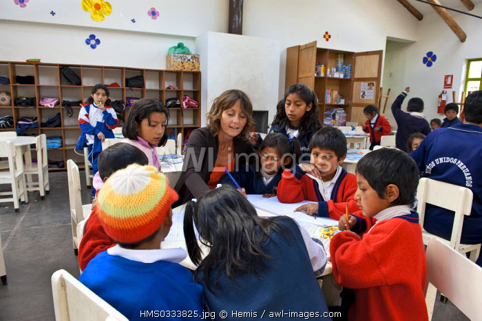 Peru, Cuzco Province, Cuzco, Jolanda van den Berg surrounded by a group of children from an educational centre managed by the Ninos Unidos Peruanos Charitable Foundation which is in charge of 600 street children and provides education, care and food by 5 educational centres