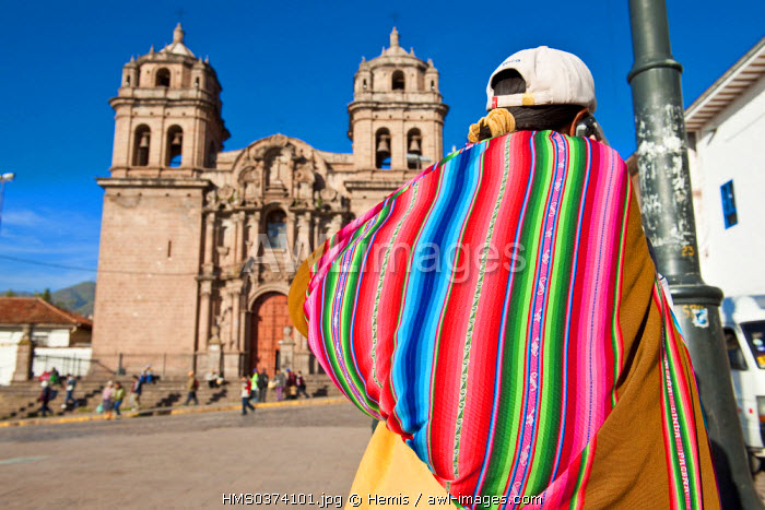 Peru, Cuzco Province, Cuzco, listed as World Heritage by UNESCO, woman with a poncho in front of San Pedro Church
