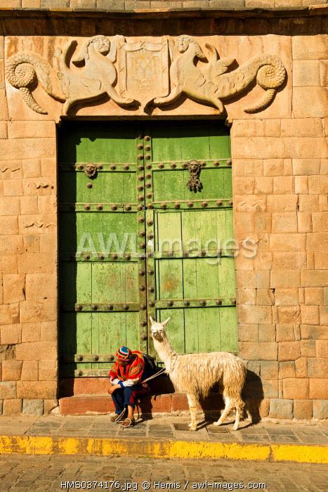 Peru, Cuzco Province, Cuzco, listed as World Heritage by UNESCO, Plaza de las Nazaneras, young Peruvian boy and his alpaca in front of Palacio Nazarenas decorated with Inca symbols