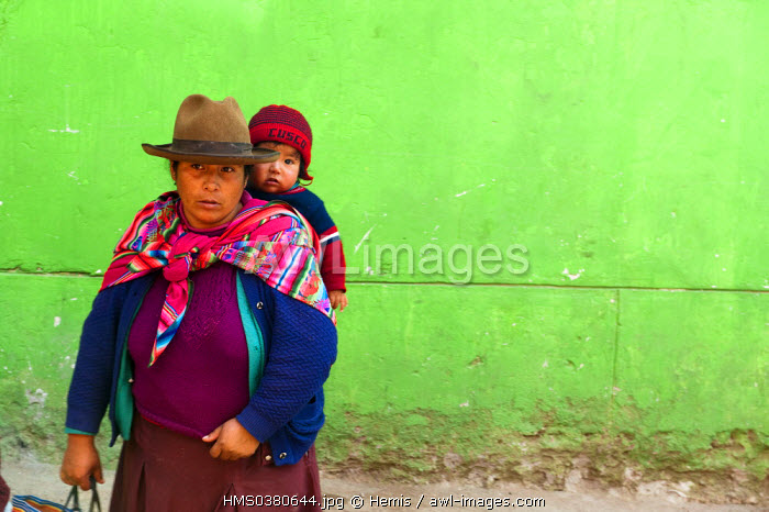 Peru, Cuzco Province, Cuzco, Quechua Indian woman carrying her child on her back