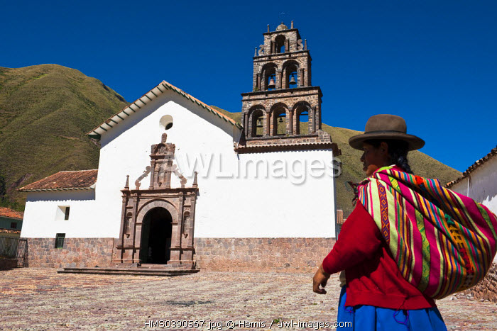 Peru, Cuzco province, Huaro, Quechua indian on the square in front of a church covered by Baroque frescoes from Cuzco school dated 17th and 18th century