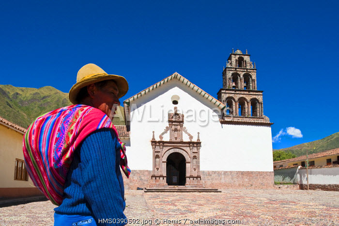 Peru, Cuzco Province, Huaro, Quechua Indian on the front of the church covered of Baroque paintings and frescoes of Cuzco School of the 17th and 18th centuries