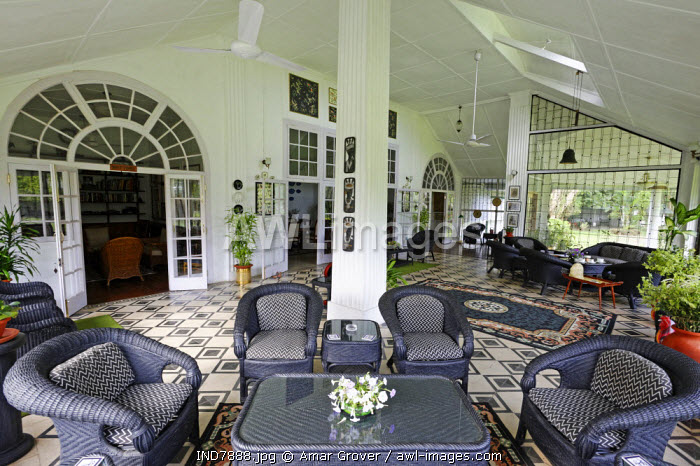 India, Assam, Balipara, Addabarie Tea Estate. The main verandah of Wild Mahseer's 'Heritage Bungalow' which was originally the residence of the tea estate's so-called visiting agent. The bungalow now offers very comfortable and characterful accommodation to visitors.