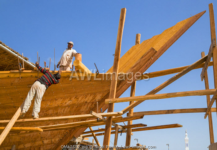 AWL Images Oman, Sur  A traditional wooden dhow under construction