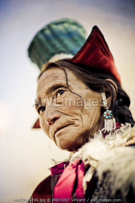 India, Jammu and Kashmir state, Ladakh, Leh, portrait of an old female Ladakhi pilgrim dancing for Losar, the Tibetan New Year
