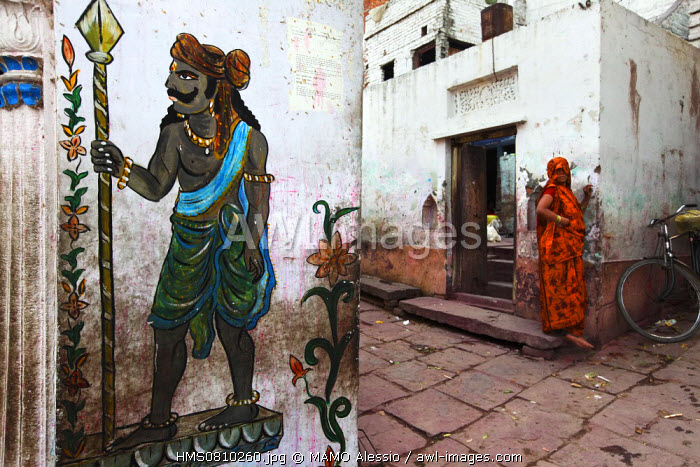 India, Uttar Pradesh State, Varanasi, woman on the doorstep
