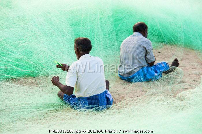 India, Tamil Nadu State, Mahabalipuram (or Mamallapuram), the fishermen mend their nets daily on the beach