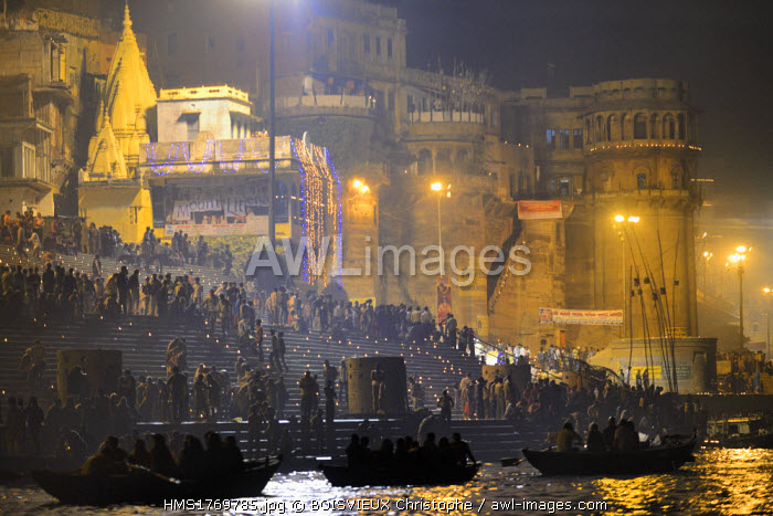 India, Uttar Pradesh, Varanasi, Boatride along the ghats during Dev Deepawali festival The Dev Deepavali festival (litterally the Diwali of the Gods) is celebrated on the full moon of the Hindu month of Kartika (November - December) 15 days after Diwali. The steps of all the ghats (stairs) on the riverfront of the Ganges are lit with thousands of earthen lamps (diyas) in honour of goddess Ganga.The gods are believed to descend on earth to bathe in the Ganges on this day.