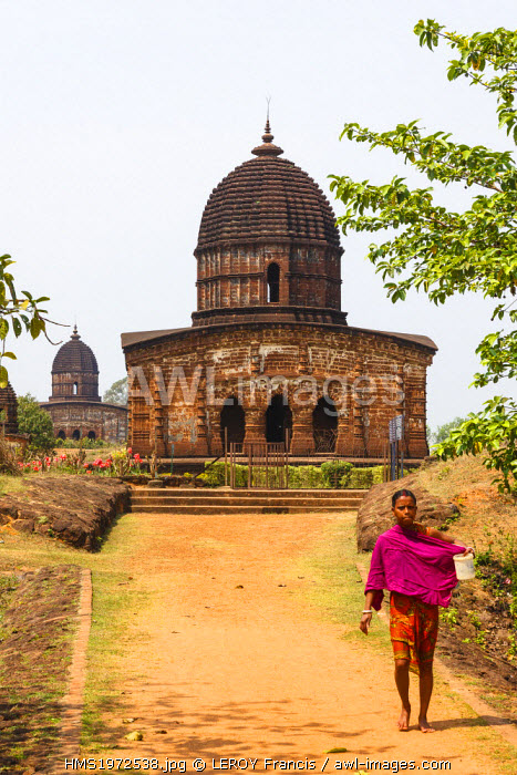 India, West Bengal, Bishnupur, woman before Radhagobinda terracotta temple (1729)