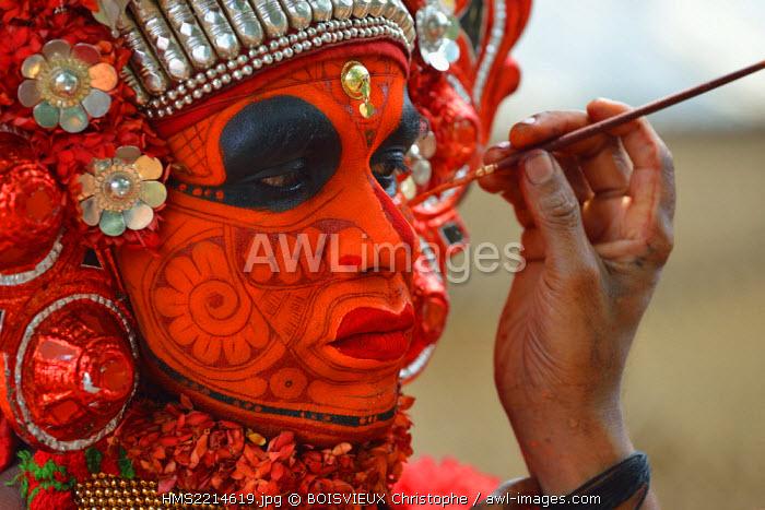India, Kerala, Kannur region, Parayangat temple, Application of make up to Theyyam Vishnumurti