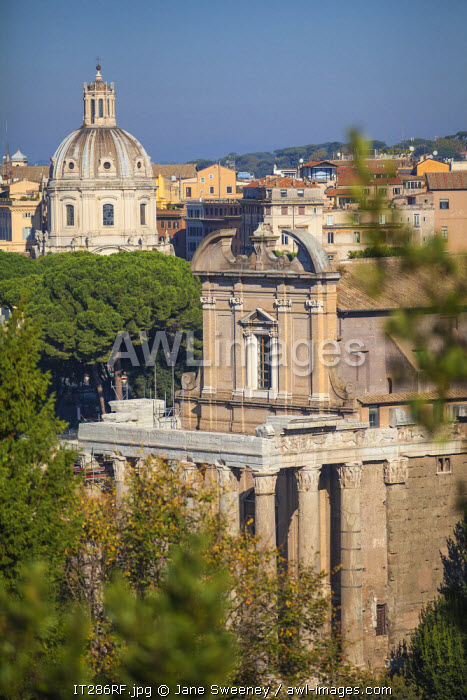 Italy, Lazio, Rome, Via Sacra, The Forum, Temple of Antoninus and Faustina - adapted to the church of San Lorenzo in Miranda. In the background is the Church of Santa Maria di Loreto