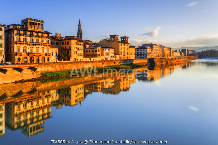 Italy, Italia. Tuscany, Toscana. Firenze district. Florence, Firenze. The river Arno, the riverside and, on the background, the bell-tower of Santa Croce church.