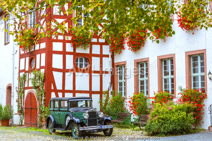 Old classical car in front of traditional building, Rudesheim, Rhine valley, Hesse, Germany