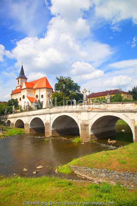 Czech Republic, Moravia, Namest nad Oslavou. Bridge and church forming part of the typical Moravian landscape.