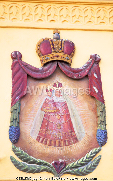 Czech Republic, Moravia, Trebic. Painted religious insignia on a wall.