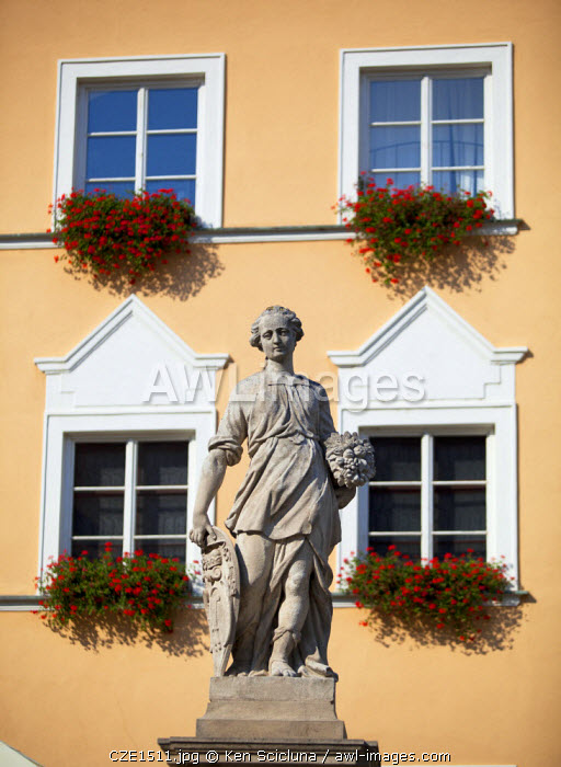 Czech Republic, Moravia, Mikulov. Detail of Statue and facade in the historical centre.