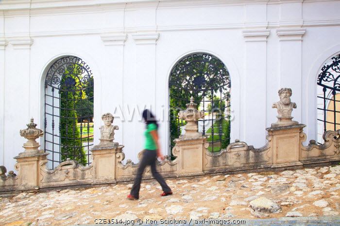 Czech Republic, Moravia, Mikulov. Young woman walking in the castle grounds.