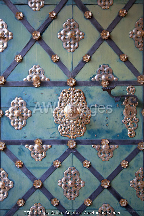 Czech Republic, Moravia, Mikulov. Detail of ornament on a metal door.