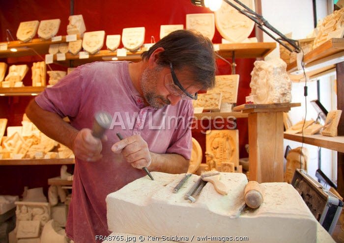 France, Normandy, Rouen. Stone carver descending from a family of craftsmen who worked mainly to design and sculpt church artefacts.
