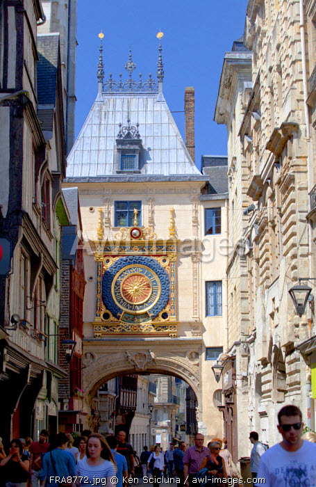 France, Normandy, Rouen. People walking in the street of the Gros Horloge in the historic quarter.