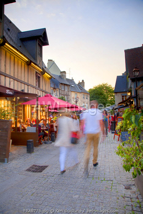 France, Normandy, Caen. Couple walking in the hsitorical centre with al fresco restaurants.