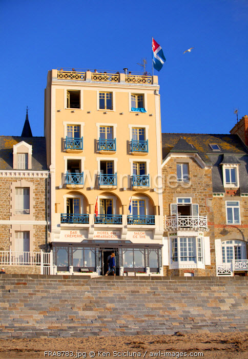 France, Brittany, Saint Malo. On the shore of the seaside town facade with town flag.