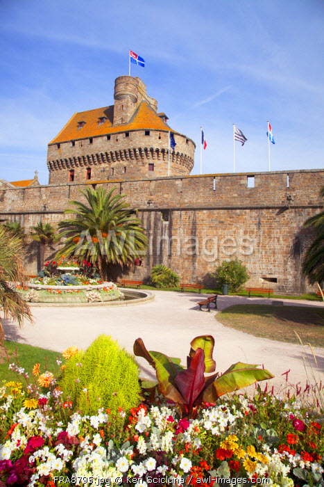 France, Brittany, Saint Malo. The old town walls with flags including the town flag on the Chateux.