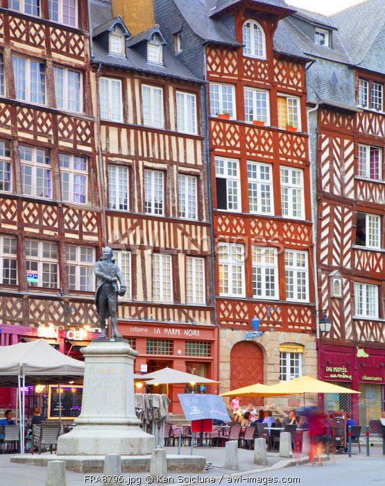 France, Brittany, Rennes. Typical wooden facades in the historical centre with staute to Jean Leperdit who served as mayor of Rennes from 1794-1795.