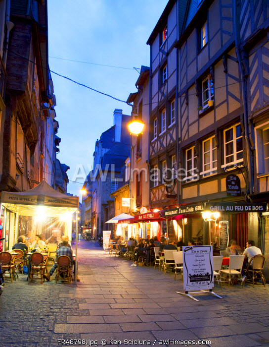 France, Brittany, Rennes. Street with al fresco restaurants and cafes with typical facades in the historical centre.