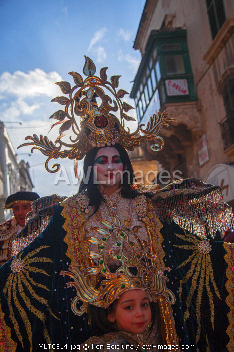 Europe, Maltese Islands, Malta. Young woman and child in costume during carnival in the streets of Valletta.