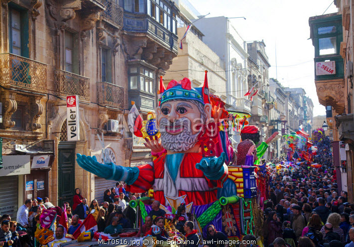 Europe, Maltese Islands, Malta. Grotesque floats passing through the streets of Valletta during Carnival.