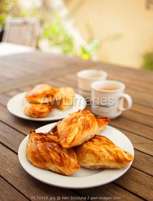 Europe, Maltese Islands, Malta. Pastizzi a traditional type of pie with pea or ricotta filling served with tea with milk rather than coffee which is reminiscent of British rule on the islands.