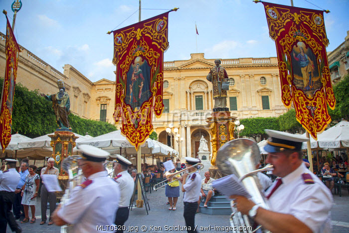 Europe, Maltese Islands, Malta. Band passing through the streets of Valletta in front of Victoria Square.