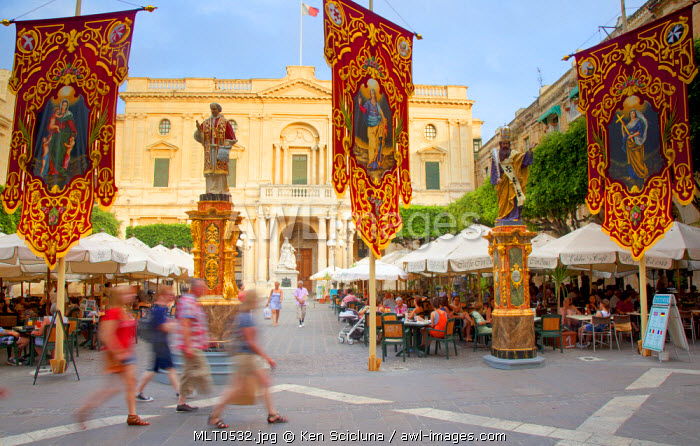 Europe, Maltese Islands, Malta. People passing through the streets of Valletta in front of Victoria Square.
