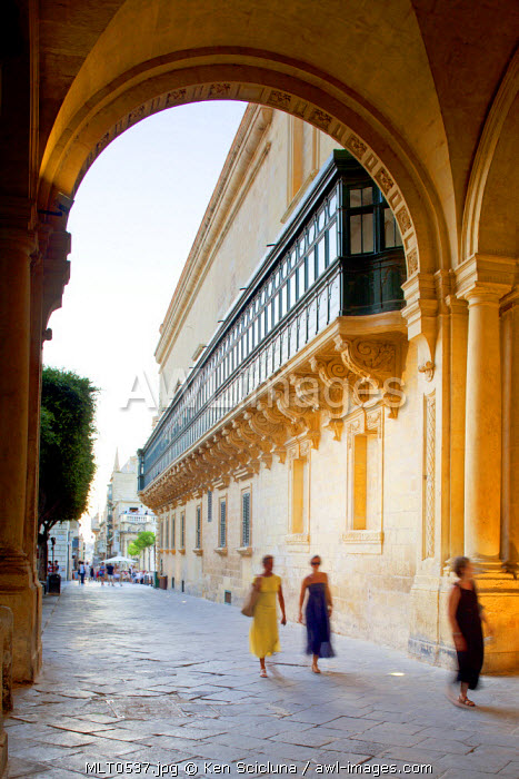 Mediterranean Europe. Maltese Islands. Malta. Women walking under one of the arches in the centre of the capital of Valletta.